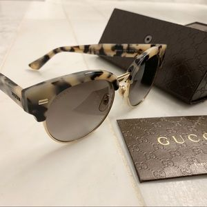 Gucci Turquoise framed sunglasses from Milan